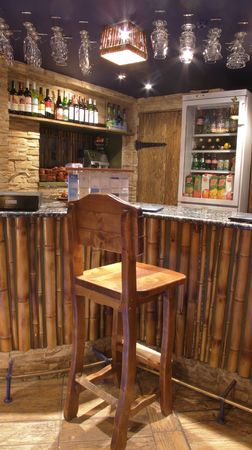 The wooden chair from the bar. Bamboo Bar basin. Stoel high, massive. Wooden parquet. photo