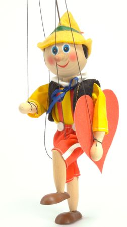 joyfully: Wooden doll - marionette. Joyfully it steps with the enormous red