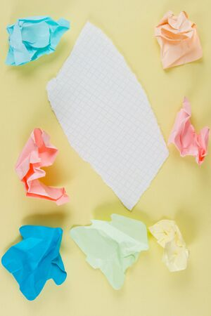 Crumpled and torn paper. At yellow backgeound. The model for posting your pictures or inscriptions. Stock Photo - 3485720