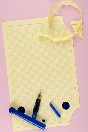 Torn paper and pen. At pink background. The model for posting your pictures or inscriptions. Stock Photo - 3485728