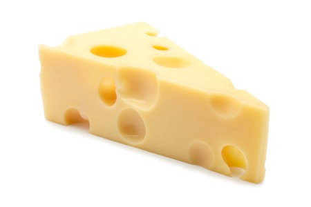 A piece of cheese, fresh and fragrant. There are many holes. Isolated on a white background.