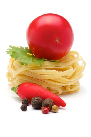 mediterranean cuisine: Composition of: Tagliatelle, tomatoes, spices, parsley, chili pepper. Close-up. Isolated on white background.