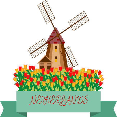 Windmill in a field against a background of tulips.The symbol of Holland.