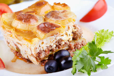 Greek cuisine. Moussaka - casserole of minced meat and vegetables photo