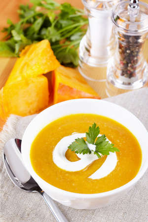 Pumpkin soup on the served table Standard-Bild