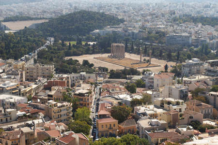 Greece, Athens. View of the city and the Temple of Olympian Zeus photo