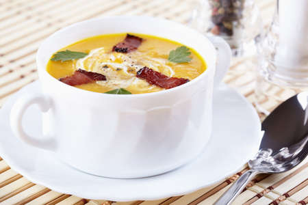 Pumpkin soup with smoked bacon photo
