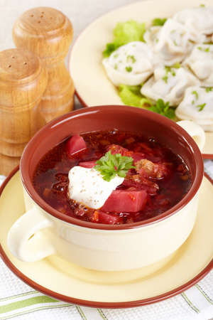 Russian cuisine. Borscht and pelmeni on the served table