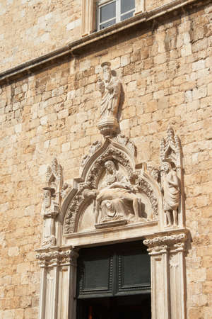 franciscan: Croatia, Dubrovnik. The portal above the entrance to the Franciscan monastery Stock Photo