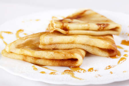 Thin pancakes with honey and powdered sugar
