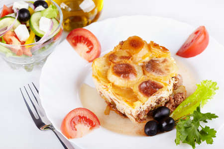 Greek cuisine. Moussaka and greek salad photo