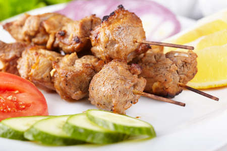 Pork shashlik with fresh vegetables photo
