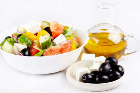 Greek salad, cheese, olives and olive oil photo
