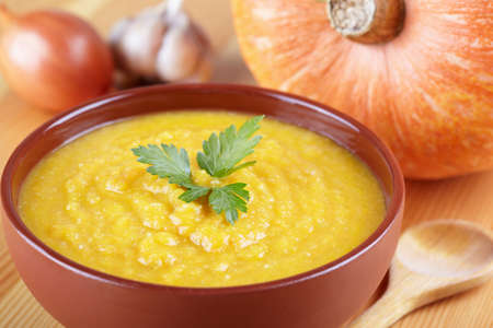 Pumpkin soup on the served table Stock Photo - 12923061