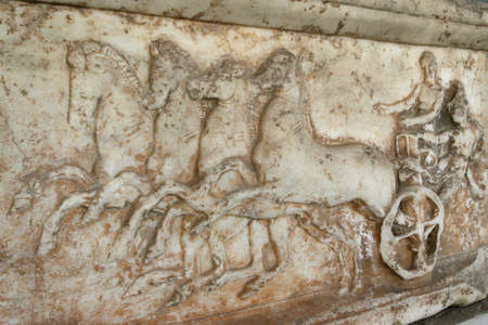 classical greece: Greece, Athens. Ancient Agora. Ancient greek marble slab with the chariot represented on it Stock Photo