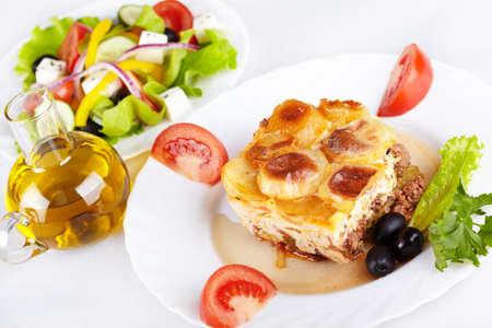 Greek cuisine. Moussaka and greek salad