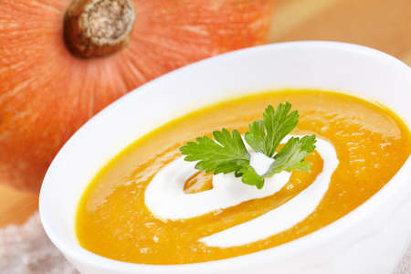 Pumpkin soup in white plate Stock Photo - 13243755