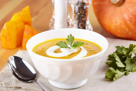 Pumpkin soup on the served table Stock Photo - 13429606