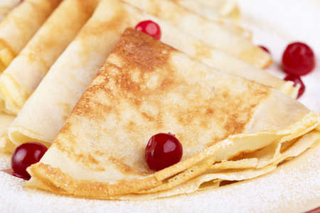 Pancakes with cranberry berries on a plate Stock Photo