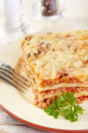 Italian cuisine. Meat lasagna  on the served table photo