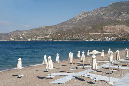 Greece, Lutraki  The closed parasols on the coast of gulf of Corinth Standard-Bild