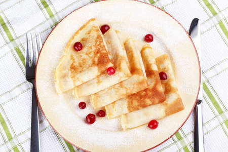 maslen: Pancakes with cranberry berries on a plate Stock Photo