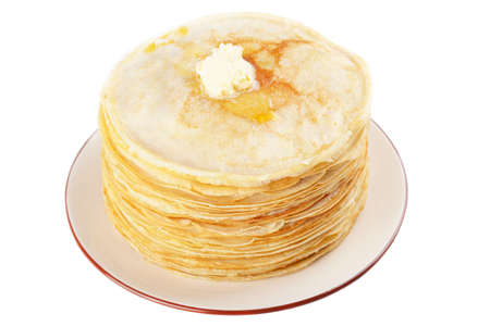maslen: A stack of thin pancakes with butter Stock Photo