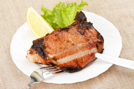 Grilled meat on white plate photo