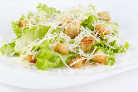 grated parmesan cheese: The Caesar salad prepared on the classical recipe Stock Photo