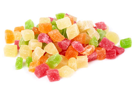 Colorful candied fruit on a white background