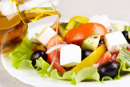 Vegetable salad with cheese and olive oil photo