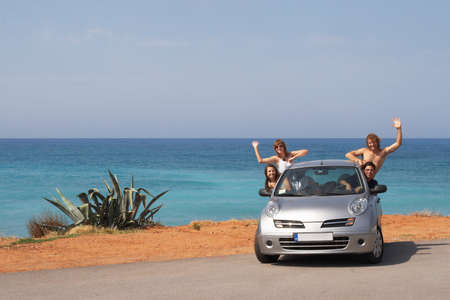 rent car: The company of young people traveling by car Stock Photo