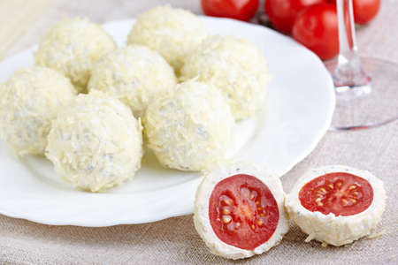 Cheese balls with a tomato cherry Stock Photo - 21777460