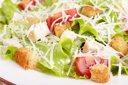 caesar salad: The Caesar salad with chicken and tomatoes