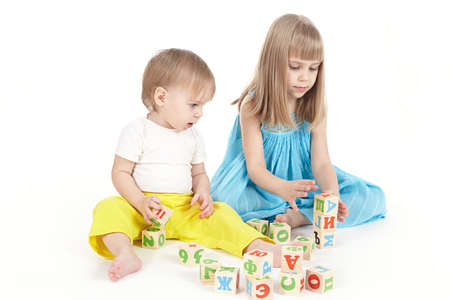 Two children play with cubes Standard-Bild