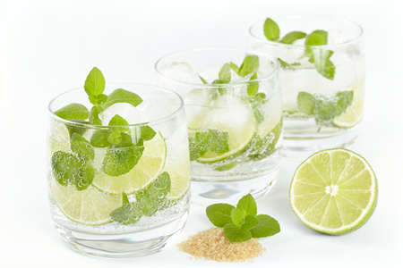 Three glasses with Mojito cocktail on a white background photo