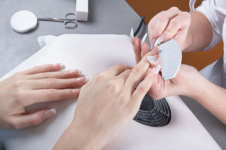 nail file: Manicure. Processing of extended nails by a nail file