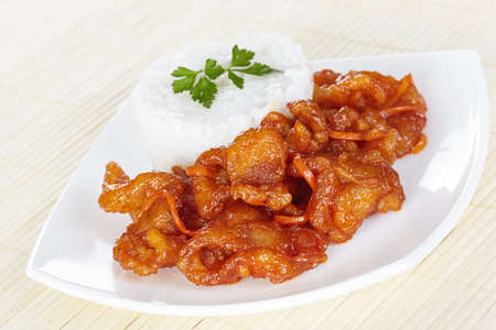 Chinese cuisine. Pork in batter and sweet and sour sauce Stock Photo