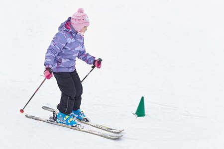 Girl learning to ski Stock Photo