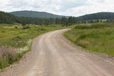 receding: Russia. Rural landscape. Road receding into the distance