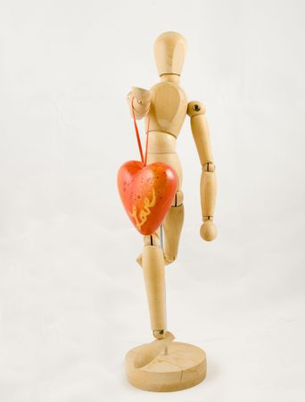 Symbol of love, manikin giving a heart Stock Photo - 2854054