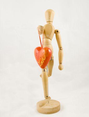 Symbol of love, manikin giving a heart Stock Photo - 2854054