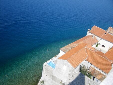 Red roof at the Adriatic sea background Stock Photo