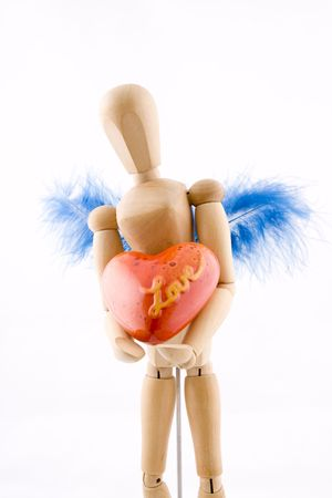 Symbol of love, manikin giving a heart photo