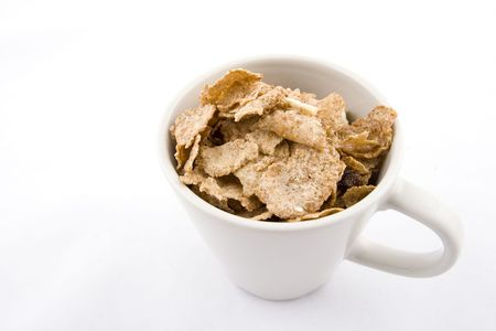 musli: Cup  full of musli and dried fruits  Stock Photo