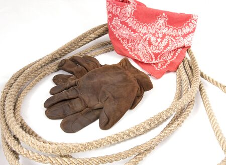 Cowboy gear - western riding equipment, gloves and rope