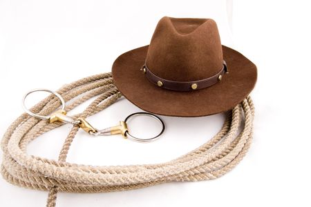 Cowboy gear - western riding equipment, hat and rope