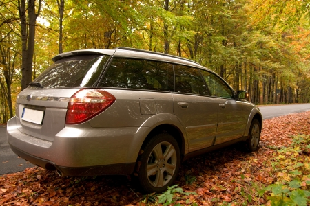 Car parking in the autumn forest