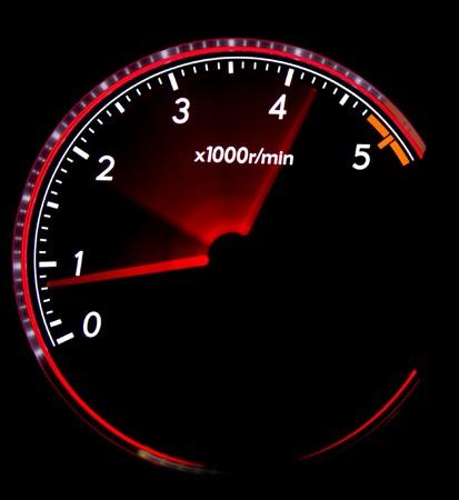 Car dashboard gauges illuminated at night, tachometer, speedometer Stock Photo