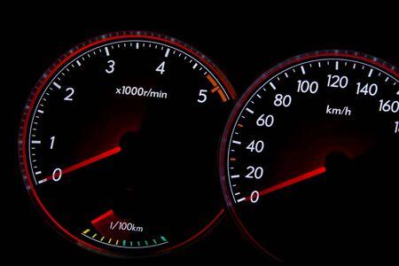 prix: Car dashboard gauges illuminated at night, tachometer, speedometer Stock Photo